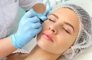 preparation-of-the-patients-face-to-a-cosmetic-procedure-picture-id509294104